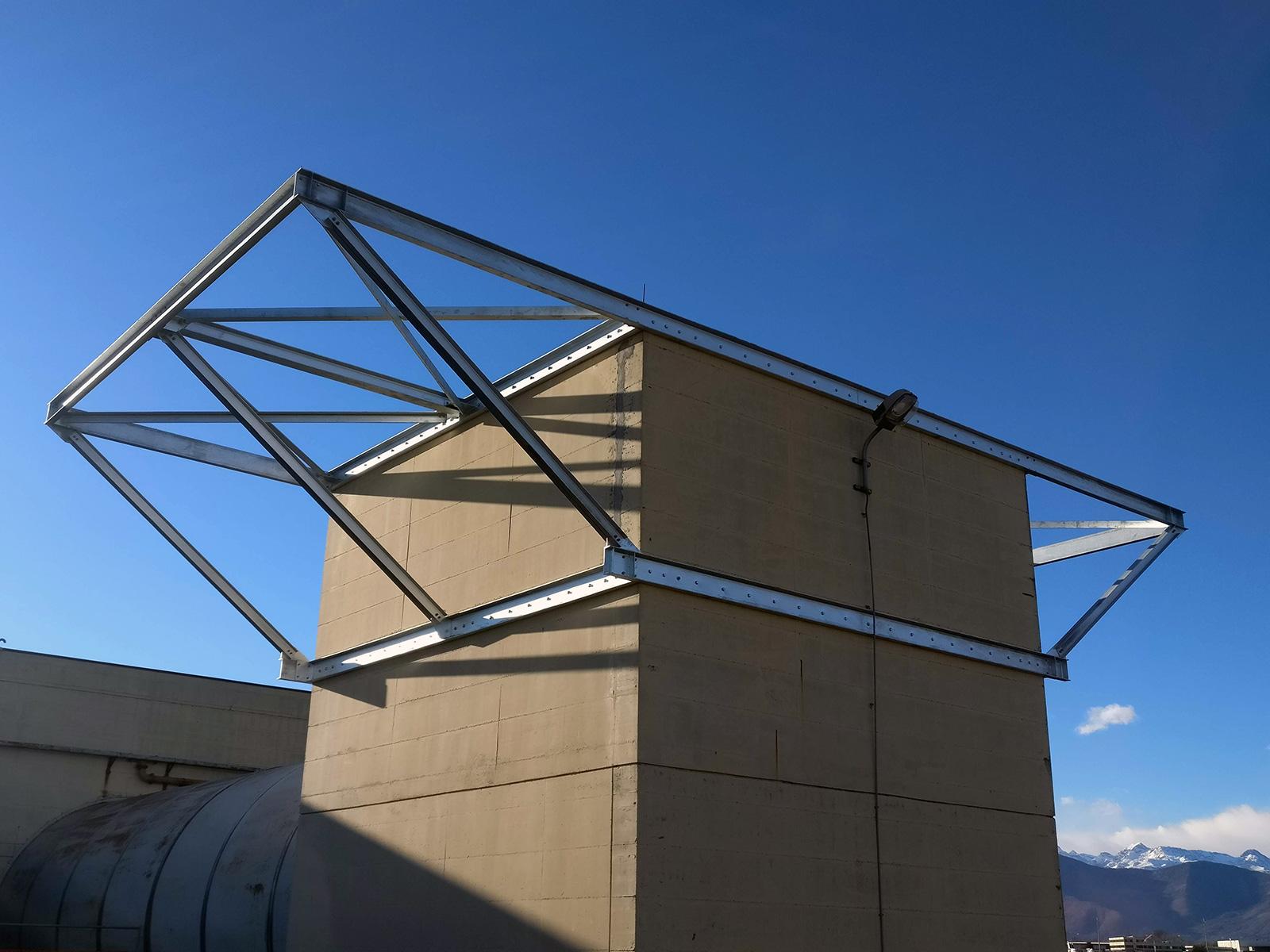Gruppo Ingegneria Torino - Copertura telescopica di un camino silenziatore